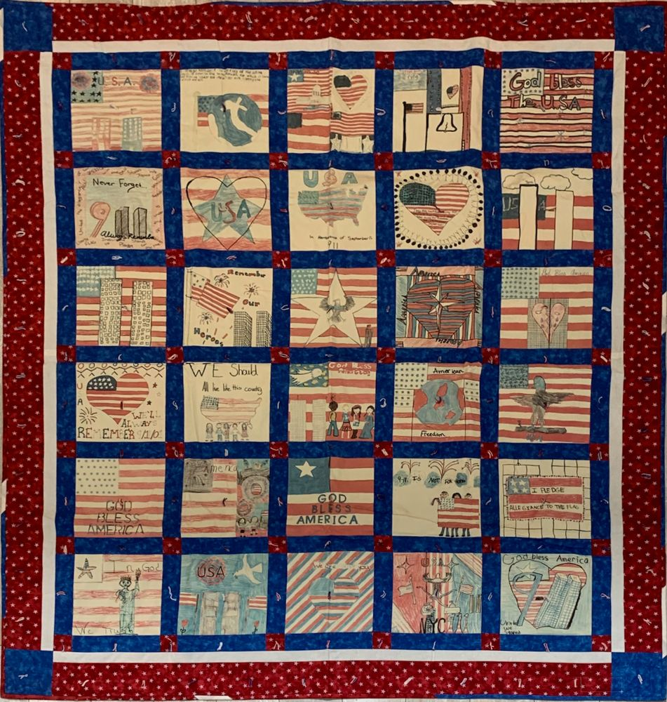 Quilt with childrens' art squares